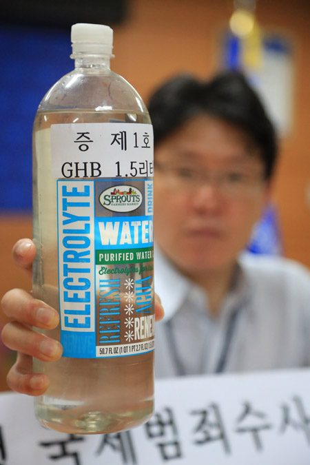 A 1.5-liter bottle of gamma hydroxybutyrate (GHB), confiscated from Lewis.