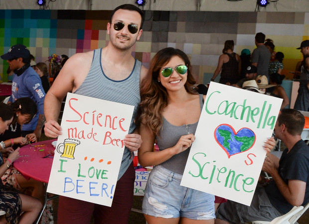 Omar Sanchez, 31, and Zoe Cabral, 27, both of Los Angeles, shoe off their signs before the Coachella version of the national March for Science during the second day of the second weekend of the Coachella Valley Music and Arts Festival at the Empire Polo Club in Indio, CA on Saturday, April  22, 2017. (Photo by Kevin Sullivan, Orange County Register/SCNG)